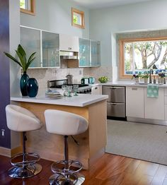 Seaside-Inspired Kitchen A pass-through made this U-shape kitchen feel boxy and closed in. But by removing the cabinets above the peninsula, the kitchen was revived. With no other demolition or construction needed, the rest of the kitchen remodel focused on adding a unique and personalized touch to the cookie-cutter kitchen.