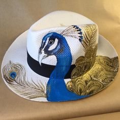 Hand painted Panama hat by Vmixo Peacock Canvas, Peacock Painting, Fabric Painting, Painted Hats, Painted Clothes, Hand Painted, Customised Clothes, Hat Decoration, Fancy Hats