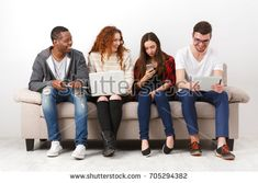 Multiethnic young students study with gadgets, preparing for exam, sitting on sofa in living room, studio shot Student Studying, Studio Shoot, Mom Jeans, Gadgets, Students, Sofa, Living Room, Fashion, Moda