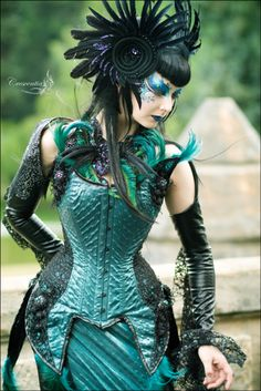 Wild and flamboyant neo-Victorian outfit in teal and black...love that corset and headpiece!