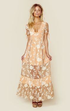 """This gorgeous maxi dress by For Love and Lemons oozes romance with its floral embroidery throughout, mesh paneling on the skirt, and pretty peach hue.   ImportedDry Clean OnlyNylon BlendFit Guide:Model is 5ft 7 inches; Bust: 32"""", Waist: 24"""", Hips: 34""""Model is wearing a size XSRelaxed FitShoes Featured Not Available For Purchase"""