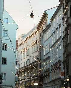Hanging lights through the streets to get in the festive spirit