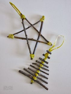 colored striped: DIY Christmas or Holiday decorations from tree branches, hot glue, and straw thread.