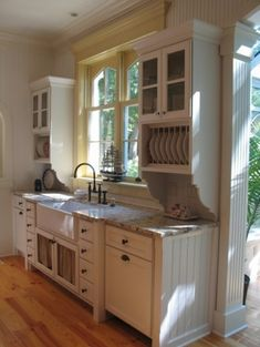 side cabinets, cottage kitchen. Love the combo of the white cabinets and neutral counter