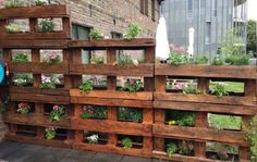 Modern Wooden Pallet Fences Pallet Planter- would love this for the bunnies in the backyard. Could put lettuce in them on the lower level!Pallet Planter- would love this for the bunnies in the backyard. Could put lettuce in them on the lower level! Vertical Pallet Garden, Wood Pallet Planters, Pallets Garden, Vertical Gardens, Wood Pallets, Wood Pallet Fence, Pallet Gardening, Fence Stain, Planters On Fence