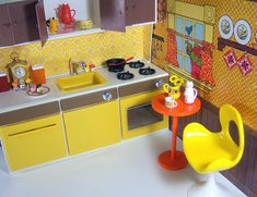Vintage Illco's Toy Kitchen with a Jody Country Kitchen backdrop.