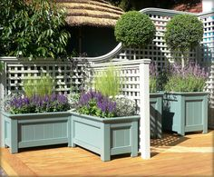 trellis, planter boxes and stained or sealed wooden deck - lots of painting & project ideas here.Decorative trellis, planter boxes and stained or sealed wooden deck - lots of painting & project ideas here. Small Garden Ideas Privacy, Garden Privacy, Garden Trellis, Garden Fencing, Privacy Trellis, Privacy Planter, Trellis Fence, Trellis Ideas, Outdoor Privacy