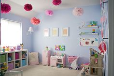 I like the poms idea for a playroom but maybe shove a whole bunch of them together in one corner?