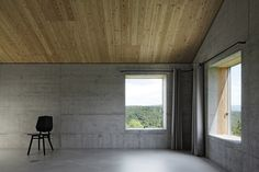 Isolated Swiss Countryside Home With Glass-Encased Lower Floor