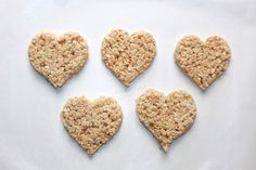 Heart-shaped treats for Valentine's Day -- stop there, or go the extra mile and turn them into DIY Rice Krispies Heart Pops from @Handmadebykelly. Click for the easy how-to.