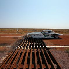 Primavera of EAFIT-EPM Solar Car Team Colombia crosses a cattle grid as it races in the Challenger Class on October 21 2015 outside of Coober Pedy Australia. Teams from across the globe were competing in the 2015 World Solar Challenge  a 3000 km solar-powered vehicle race between Darwin and Adelaide. Photograph by @markkolbe of @gettyimages for The World Solar Challenge. by time