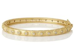Studded eternity clear stone hinge bangle in fourteen karat gold plated sterling silver. Designer:Freida Rothman $ 295.00 Item #: A6JTAQ Call 870-863-8818 for personal consultation.