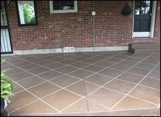 Great idea... and cheap. Stained concrete patio to look like tile. I want to do this