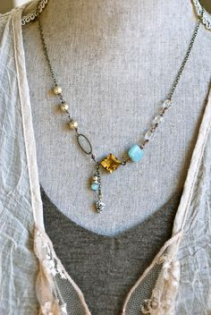 Oh so lovely! features vintage faux glass pearls,crystal beads,amazonite gemstones,light topaz rhinestone,white caped snow pinecone charm,anrique