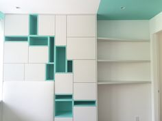 carpentry details. Millwork . Push latch doors. White satin carpentry. Contemporary carpentry . Pops of color . Designed by DKORistas from DKOR interiors. Upholstered headboard. Teal carpentry. Kids bedroom design . Contemporary interior design