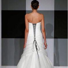 Issac Mizrahi corseted back wedding gown.