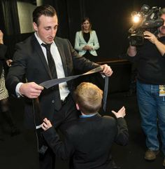 Marchy presents a tie to Danny Keefe