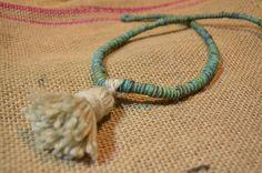 """Tassle tied"" necklace handmade in Nepal from hemp fibres, with the tassle added in Brisbane studio."