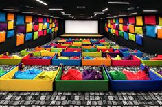 as innovative as it is relaxed, the cinema is decorated with bright colored tuli brand beanbags, acoustic wall panels and screen-oriented cubicles.