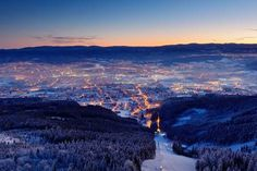 Town Liberec with winter mountain forest before sunrise. Czech early morning snow landscape pink and violet light. Snowy trees with fog, Jizerske hory, north of Bohemia, Czech republic. Light in town. Snowy Trees, Winter Mountain, Heart Of Europe, Before Sunrise, Casino Royale, Mountain Landscape, Early Morning, Czech Republic, Countryside