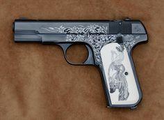 Engraved 1903 hammerless Colt pistol