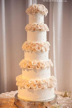 simple but elegant wedding cake - maybe less layers and sunflowers instead?! Gorgeous!