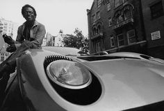 Musician Miles Davis sitting on the hood of his Lamborghini in a work shirt and long pants. Get premium, high resolution news photos at Getty Images Lamborghini Miura, Green Lamborghini, Miles Davis, Maserati, Ferrari, Johnny Cash, Freddie Mercury, Le Mans, Pictures Of Rocks