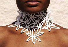 Marzio Fiorini: love this Brazilian designer's laser-cut rubber jewelry.  http://www.marziofiorini.com.br/