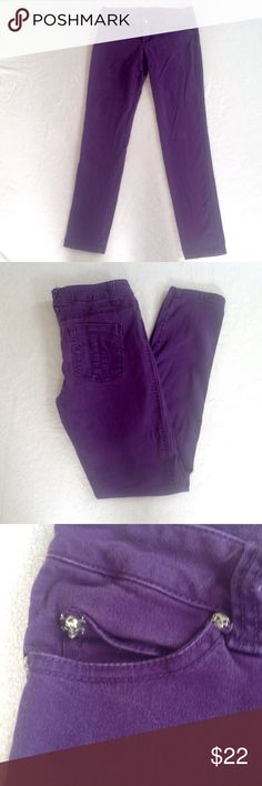 "Dark purple skinny jeans These purple skinny jeans make a great statement piece for your outfits! Colored denim is a hot trend this fall. Tripp NYC brand from Hot Topic, size 5. They have little skull details on the pockets, and a unique design on the back pockets.   Materials: 97% cotton, 3% spandex Condition: excellent - no rips, no stains  Measurements: Waist: 14.5"" Rise: 7.25"" Inseam: 29"" Leg opening: 5.25""  No trades No holds No modeling Bundle 2 or more items to save! Tripp nyc Pants…"