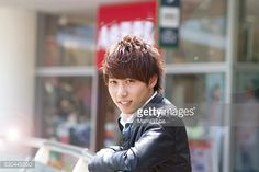 Stock Photo : Young man waiting and smiling in the city
