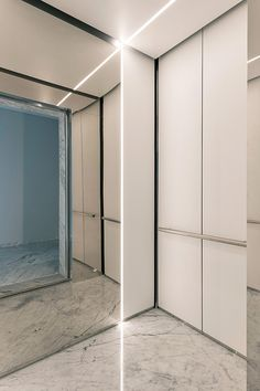 LEVELe-105 Elevator Interior with customized panel layout; Minimal panels in Bonded Quartz, White with custom pattern, Stainless Steel with Mirror finish; Round handrail at Yoo Pune, Pune, Maharashtra, India