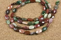 Multicolored Imperial Jasper Beads - Faceted Oval Pink, Purple and Green Beads, 15.5 inch strand by abosbeads. Explore more products on http://abosbeads.etsy.com