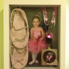Shadow box with dance picture, my little girl's first pair of ballet shoes, and her dance medal