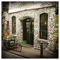 Hoboken Cafe, Hosier Lane, Melbourne. The entire alleyway is alive with colorful graffiti and artwork, and is a top spot for wedding, engagement and other photos.