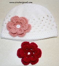 http://crochetjewel.com/?p=13479 Crochet toddler hat with button-on interchangeable flower. From Crochet Jewel.