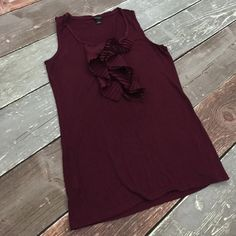 Ann Taylor tank EUC burgundy tank with satin ruffle detail. 96% rayon 4% spandex. Material has nice stretch and falls in a flattering way against the body. Ann Taylor Tops Tank Tops