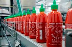 A small Southern California town has turned up the heat on the makers of the wildly popular Sriracha hot sauce, telling them that if they can't keep their bottling plant from smelling up the neighborhood, the city will.