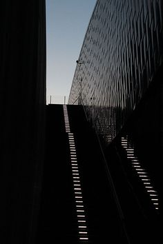 White steps leading to modern black architectural buildings.   I love the dramatic, yet subtle steps, almost art itself.