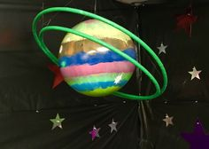 "Planet made from $2.88 ball from Walmart that I painted and the ""rings"" are hula-hoops from the dollar tree."
