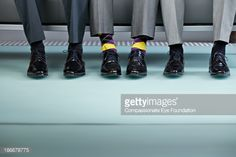 Stock Photo : Three men sitting on bench, view of shows