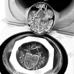 Solid signet rings with bespoke hand engraving by Master Hand Engraver, Ray Hood.