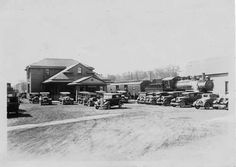 Image of the York Street Train Station showing rolling stock and cars parked in the railway yard, taken circa York Street, Rolling Stock, New Brunswick, Train Station, Car Parking, Canada, Yard, History, Outdoor