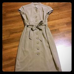Khaki dress Polyester, rayon, spandex mixed khaki colored dress.  Fits very nicely with belted waist.  Fully lined! Dresses