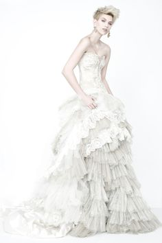 Drape your inner goddess with this striking combination of a metallic tulle and Solstiss lace skirt with a luxurious, seemingly endless tail and a lavish, Swarowski crystal adorned bodice with a sweetheart neckline. White Wedding Dresses, Bridal Dresses, Wedding Gowns, Wedding Bride, Amazing Weddings, Unique Weddings, Wedding Heels, Beautiful Gowns, Bridal Collection