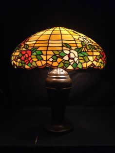 http://www.ebay.com/itm/Antique-Leaded-Glass-SHADE-Duffner-Kimberly-Tiffany-ARTS-Crafts-Large-22-/171546599012?pt=Antiques_Decorative_Arts