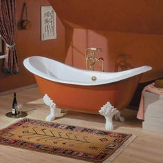 Beautiful burnt-orange Regency cast iron tub with lion feet. What a centerpiece! www.cheviotproducts.com/   Color?