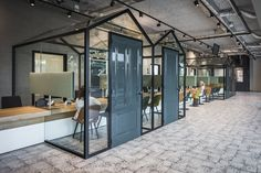 The new office had to combine two functions: a semi-secure public space to meet with clients, and a separate office space with workspaces. Work Cafe, Grey Office, Coworking Space, The Tenant, Office Interiors, Building Design, Minimalism, Flooring, Interior Design