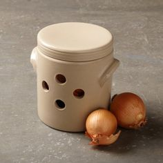 a great way to store onions...onions deserve to be treated well too.   Stoneware Onion Pot #WilliamsSonoma