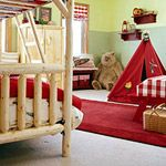 Bringing a little bit of the outdoors in!  Red is such a nice bright color for a child's room and goes extremely well with the wooden log-like furniture.