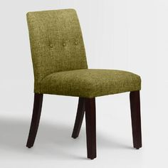 Featuring a mid-century modern silhouette with a low profile back, our custom-made dining chair is handcrafted of solid pinewood with soft linen-blend upholstery and hand-tufted button details. Accentuate your dining decor with this on-trend chair in your choice of colors, mix with your current chairs, or pair it with a vanity or accent table.